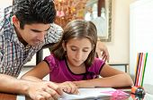picture of preteen  - Young father helping her daughter with her school project at home - JPG