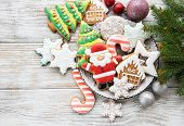 Christmas Cookies And Christmas Tree On A Old Wooden Background poster