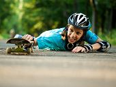 stock photo of sports injury  - Beautiful teenage girl with skateboard in the green park - JPG