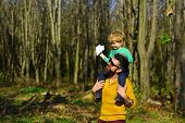 Father And Son Enjoy Walking In Spring Park. Father And Child Enjoy Sunny Day Outdoor. Love Puts The poster