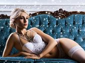 Young And Sexy Woman In Bridal Lingerie. Lady In Beautiful Underwear Posing In Vintage Interior. poster