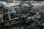 Remains Of Burnt Wooden Furniture On The Floor Of Building After Fire, Close Up poster