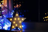 Glowing White Led Star Near Window On Warm Bokeh Background Indoor At Night. Festive Christmas Illum poster