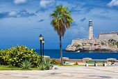 The castle of El Morro, a symbol of Havana, and a nearby romantic park on a day with a beautiful sky