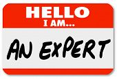 The words Hello I Am An Expert written on a red nametag or sticker for a consultant or other busines