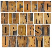 complete English alphabet - collage of 26 isolated vintage wood letterpress printing blocks, scratch