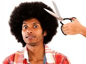 Afro man reluctant to cut his hair - isolated over a white background