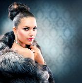 Beautiful Woman in Luxury Fur Coat