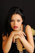 image of groupies  - Attractive latino rocker girl with her guitar - JPG