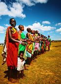 MASAI MARA,KENYA-NOVEMBER 12: Masai women sings traditional song as cultural ceremony, review of daily life of local people, near Masai Mara National Park Reserve, November 12, 2008, Kenya