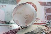 Globe On Iranian Currency