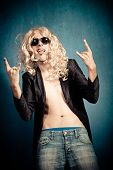 heavy metal rock star man with long blond curly hair and sunglasses parody