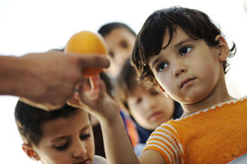 stock photo of lineup  - Hungry children in refugee camp - JPG