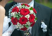 Wedding Bouquet With Roses Against The Background Of The Groom