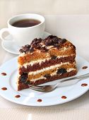 stock photo of sponge-cake  - Piece of cake with cream prunes and walnuts - JPG