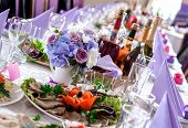 stock photo of banquet  - Wedding table decorations with food and beverages - JPG