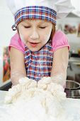 Little Girl Cooking In Kitchen