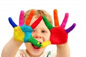 foto of finger-painting  - Five year old boy with hands painted in colorful paints ready for hand prints - JPG