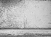 old grunge room with concrete wall, black and white background