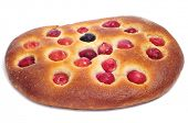 coca amb cireres, a typical catalan cake with cherries for Feast of Corpus Christi, on a white backg