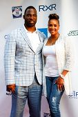 NEW YORK-MAY 30: New York Giants player Justin Tuck and actress Vivica A. Fox attend the 5th annual Tuck's Celebrity Billiards Tournament at Slate NYC on May 30, 2013 in New York City.