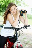 Woman On Bicycle With Binoculars