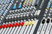 Sound Board Mixer With Focus On Red And Yellow Sliders