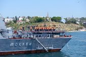 SEVASTOPOL, UKRAINE - MAY 7: Crew on the deck of Russian warship Moskva anchored in the harbor of Sevastopol, Ukraine on May 7, 2013 before the parade in honor of 230 anniversary of Black Sea navy