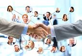 foto of handshake  - business people handshake with company team in background - JPG