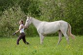 Beautiful Young Woman And Akhal-teke Horse