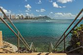 image of waikiki  - Stairs entering the ocean towards Diamond Head and Waikiki at Point Panic on the south shore of Oahu Hawaii - JPG