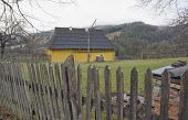 stock photo of zakarpattia  - House with well behind wooden fence in Ukrainian village - JPG