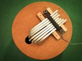 picture of idiophone  - African instrument kalimba on a green table - JPG