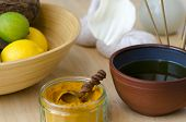 picture of ayurveda  - A table top arrangement of spice oil and massaging tools used in Ayurveda massage - JPG