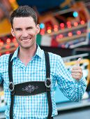 stock photo of lederhosen  - Young man wearing traditional Bavarian Lederhosen with thumbs up - JPG