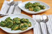 stock photo of pesto sauce  - Hand made italian Potato gnocchi with pesto - JPG