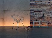 Modern living room interior with design chair against illuminted stone and wooden wall