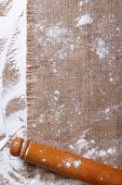 Rolling Pin On Sackcloth And Sprinkled Flour