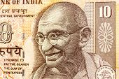 stock photo of mahatma gandhi  - Mahatma Gandhi or Mohandas Karamchand Gandhi picture on Indian Rupee Currency note - JPG