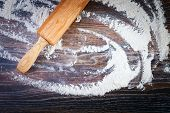 white flour on wooden table