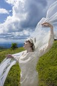 Bride with veil blowing in the wind