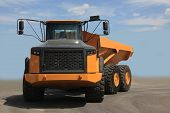 stock photo of earth-mover  - Large yellow earth mover construction dump truck - JPG