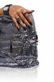 closeup of the woman's hand wearing luxury ring, black nail art manicure with sequin silver bag isol
