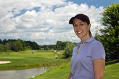 Attractive Female Golfer On The Golf Course