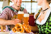 Bavarian restaurant with music, guests, wheat beer and pretzels