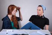 Naughty Teenagers Talking In Classroom