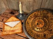mystical concept still life with zodiac sighs, candle and letter