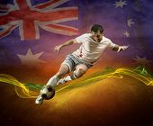 Abstract waves aroun soccer player on the national flag of Australia