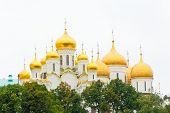 stock photo of cupola  - Photo of Orthodoxy church in Moscow with gold cupolas - JPG