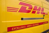 VALENCIA, SPAIN - JUNE 10, 2014: A DHL delivery van on the street in the city center of Valencia. DH